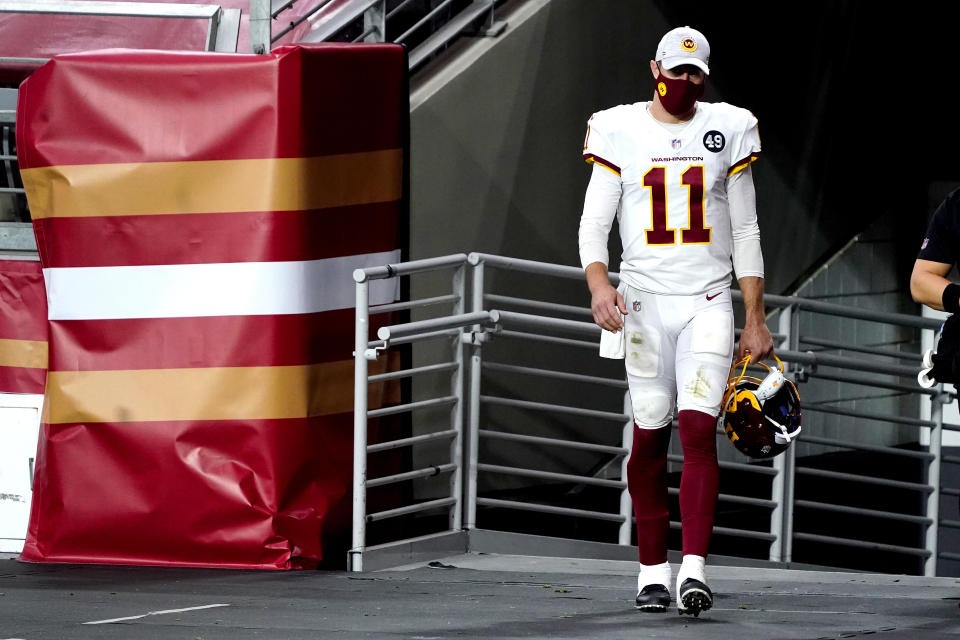 Alex Smith walks out of locker room.