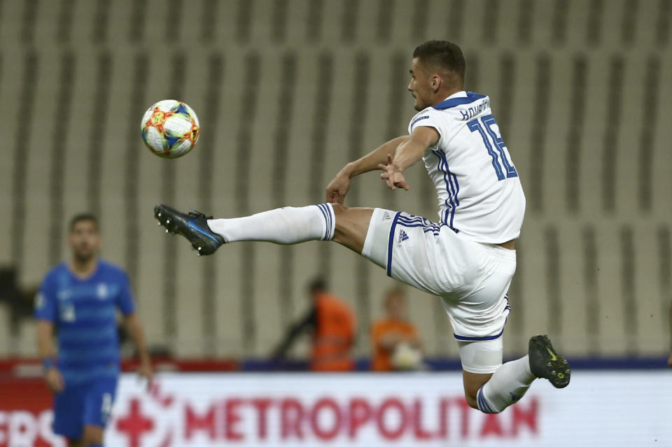 Bosnia's Adnan Kovacevic controls the ball during the Euro 2020 group J qualifying soccer match between Greece and Bosnia-Herzegovina at the Olympic stadium of Athens, Tuesday, Oct. 15, 2019. (AP Photo/Petros Giannakouris)
