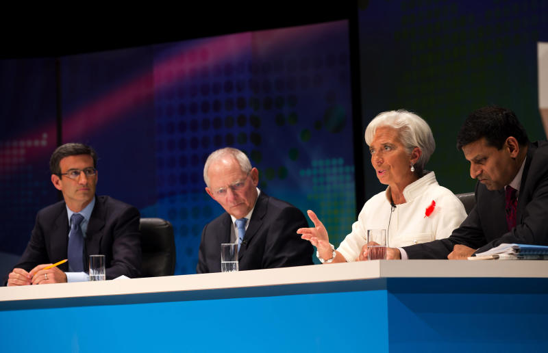 "In this photo released by the International Monetary Fund, IMF Managing Director Christine Lagarde, second right, speaks as other panelists, German Finance Minister Wolfgang Schauble, second left, Citigroup Global Banking Vice Chairman Peter Orszag, left, and India's Finance Ministry Chief Economic Advisor Raghuram Rajan, right, listen to her during the filming of the BBC World Debate ""Rescuing the Global Economy: What next?"" at the annual IMF and World Bank meetings in Tokyo Friday, Oct. 12, 2012. (AP Photo/Stephen Jaffe, IMF) EDITORIAL USE ONLY"