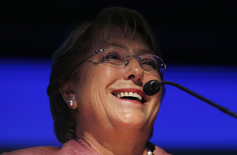 Former President Michelle Bachelet speaks to her supporters after general elections at her campaign headquarters in Santiago, Chile, Sunday, Nov. 17, 2013. Bachelet is ahead as votes are being counted in Chile's presidential election, but she is running short of the majority needed to avoid a Dec. 15 runoff. (AP Photo/Luis Hidalgo)