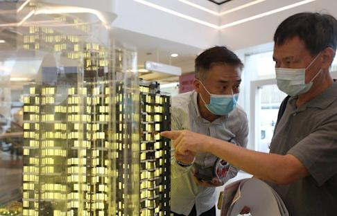Potential home buyers line up at the sales office in Mira Place One in Tsim Sha Tsui for 185 flats of Seacoast Royale on sales on 1 August 2020. Photo: Xiaomei Chen