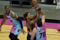 Miami Heat forward Nemanja Bjelica (70) defends against Golden State Warriors guard Kelly Oubre Jr. (12), during the first half of an NBA basketball game, Thursday, April 1, 2021, in Miami. (AP Photo/Marta Lavandier)