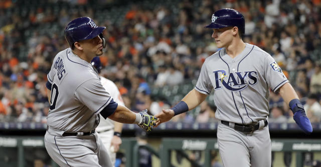 Tampa Bay Rays' Wilson Ramos, left, celebrates with Jake Bauers after both scored on Ramos' home run against the Houston Astros during the first inning of a baseball game Monday, June 18, 2018, in Houston. (AP Photo/David J. Phillip)