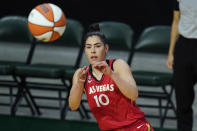 Las Vegas Aces' Kelsey Plum reaches for the ball during the first half of a WNBA basketball game against the Seattle Storm, Saturday, May 15, 2021, in Everett, Wash. (AP Photo/Elaine Thompson)