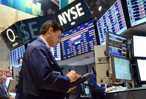 A trader works on the floor of the New York Stock Exchange at the closing bell on July 23. Facebook shares have lost nearly half their value since a highly-touted public offering in May, but it's still not a bargain for some investors