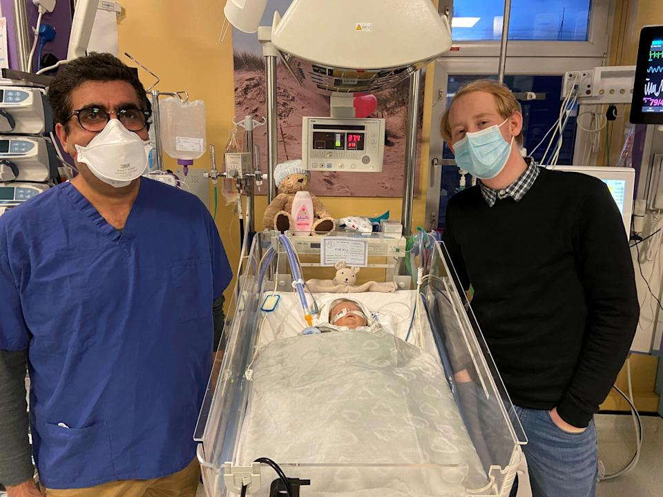 <p>Dr Akash Deep with baby Oakley Miles-Slade and father Lewis Slade</p> (Handout)