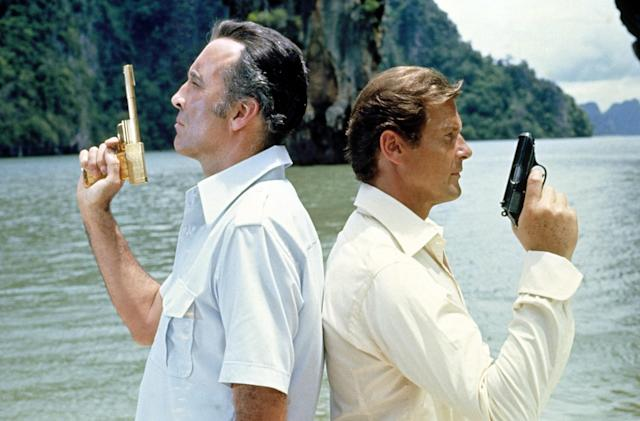 """<p>By his second Bond outing, Moore's arched eyebrow and sardonic grin were in full effect to take on <a href=""""https://www.yahoo.com/movies/tagged/christopher-lee"""" data-ylk=""""slk:Christopher Lee"""" class=""""link rapid-noclick-resp"""">Christopher Lee</a>'s golden-gunned assassin Scaramanga, who seeks a device that exploits the sun's power. (Photo: Everett Collection) </p>"""