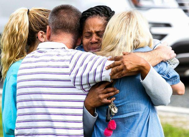 PHOTO: Nikki Brown, center, hugs others in front of Forest High School on April 20, 2018 in Ocala, Fla. (Doug Engle /Star-Banner via AP)