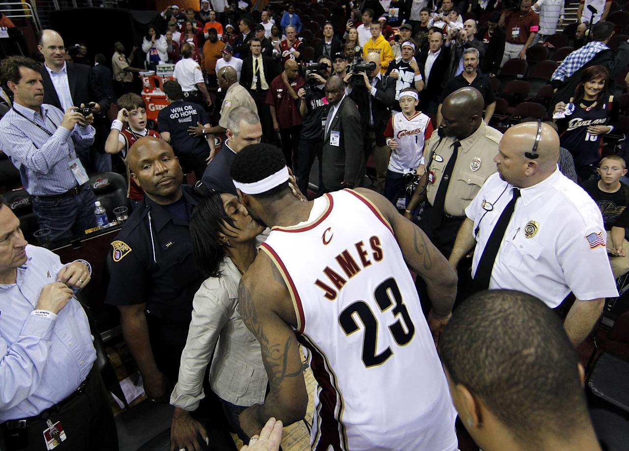 LeBron James #23 of the Cleveland Cavaliers gets a kiss from his mother while leaving the floor after being defeated 120-88 by the Boston Celtics in Game Five of the Eastern Conference Semifinals during the 2010 NBA Playoffs at Quicken Loans Arena on May 11, 2010 in Cleveland, Ohio. NOTE TO USER: User expressly acknowledges and agrees that, by downloading and or using this photograph, User is consenting to the terms and conditions of the Getty Images License Agreement. (Photo by Gregory Shamus/Getty Images)