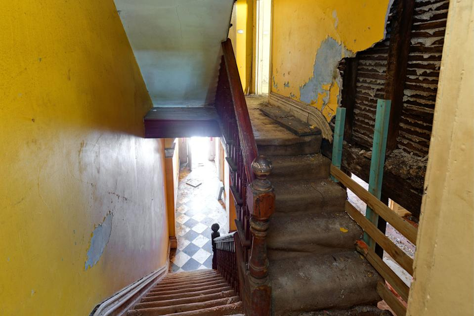 A dilapidated staircase inside a home at Darlinghurst in Sydney.