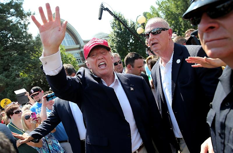 Republican presidential candidate Donald Trump greets fairgoers while campaigning at the Iowa State Fair on August 15, 2015