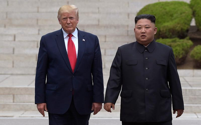 President Donald Trump meets with North Korean leader Kim Jong Un at the North Korean side of the border at the village of Panmunjom in Demilitarized Zone. - AP