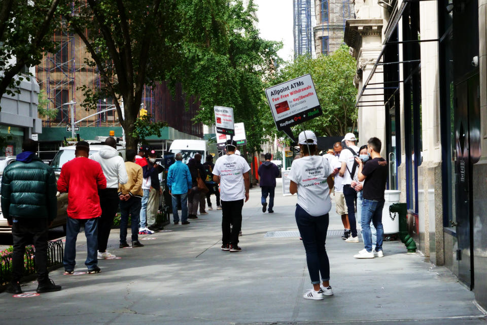 Long lines of unemployed waiting to enter bank and cash their benefit cards, Manhattan, during Coronavirus shutdown. (Photo by: Joan Slatkin/Education Images/Universal Images Group via Getty Images)