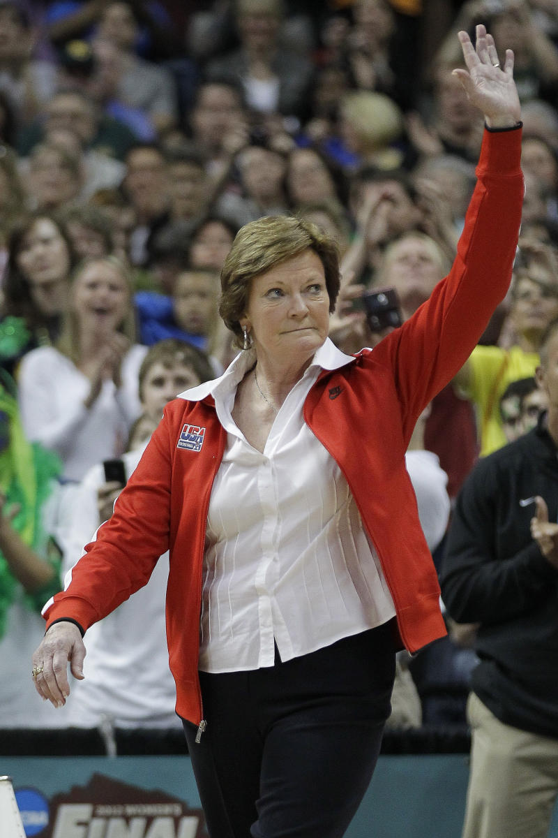 Tennessee coach Pat Summitt  waves to the crowd during a half-time ceremony to honor past olympic coaches at an NCAA women's Final Four semifinal college basketball game between the Baylor and the Stanford, in Denver, Sunday, April 1, 2012. (AP Photo/Julie Jacobson)