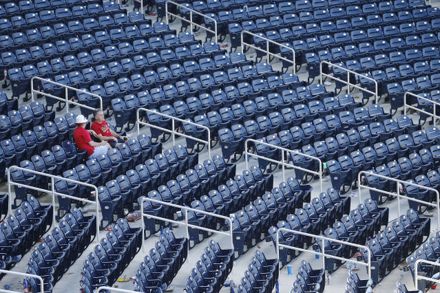 Empty ballparks could have devastating ripple effects for workers in a host of industries fueled by baseball games. (Photo by Michael Reaves/Getty Images)