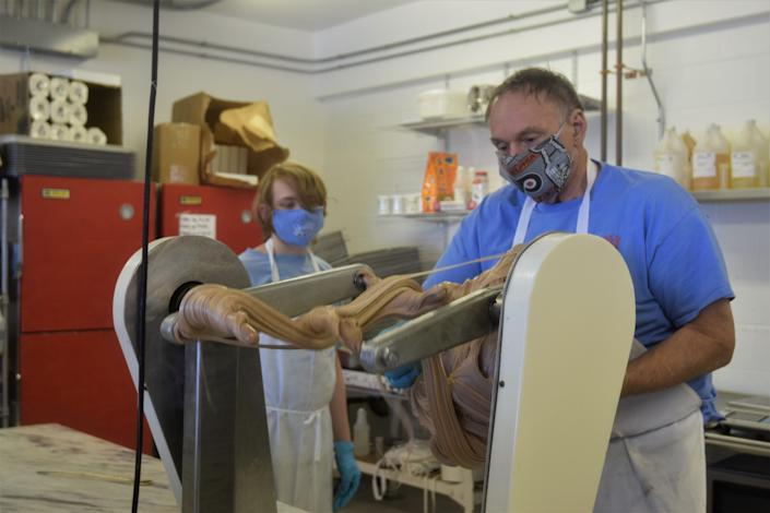 Dolle's owner Tom Ibach works on a fresh batch of saltwater taffy.