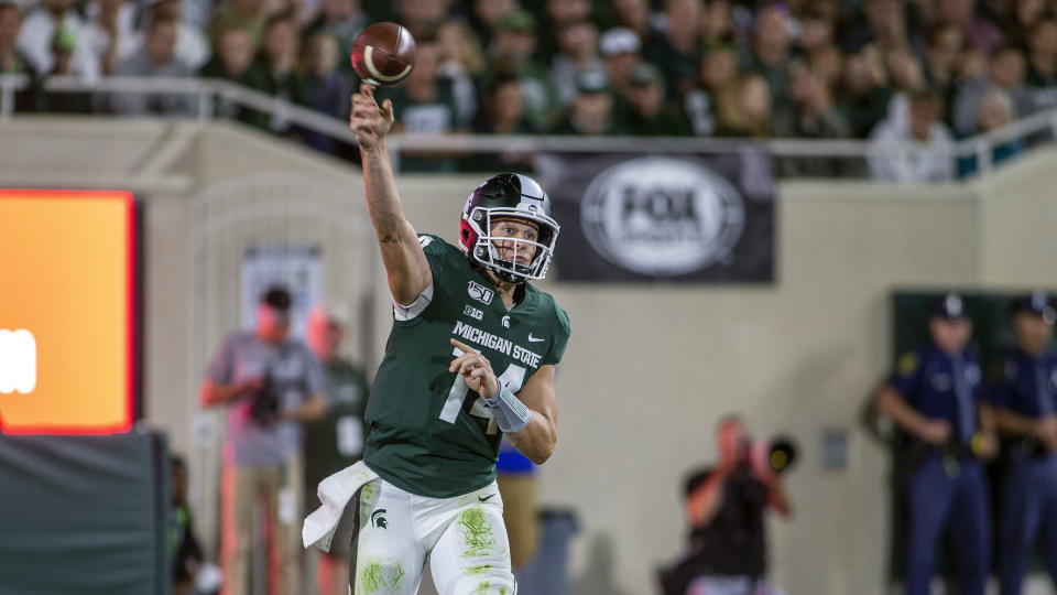 Michigan State quarterback Brian Lewerke (14) throws a pass during the second half of an NCAA football game against Tulsa on Friday, Aug. 30, 2019 in East Lansing, Mich. Michigan State won 28-7. (AP Photo/Tony Ding)