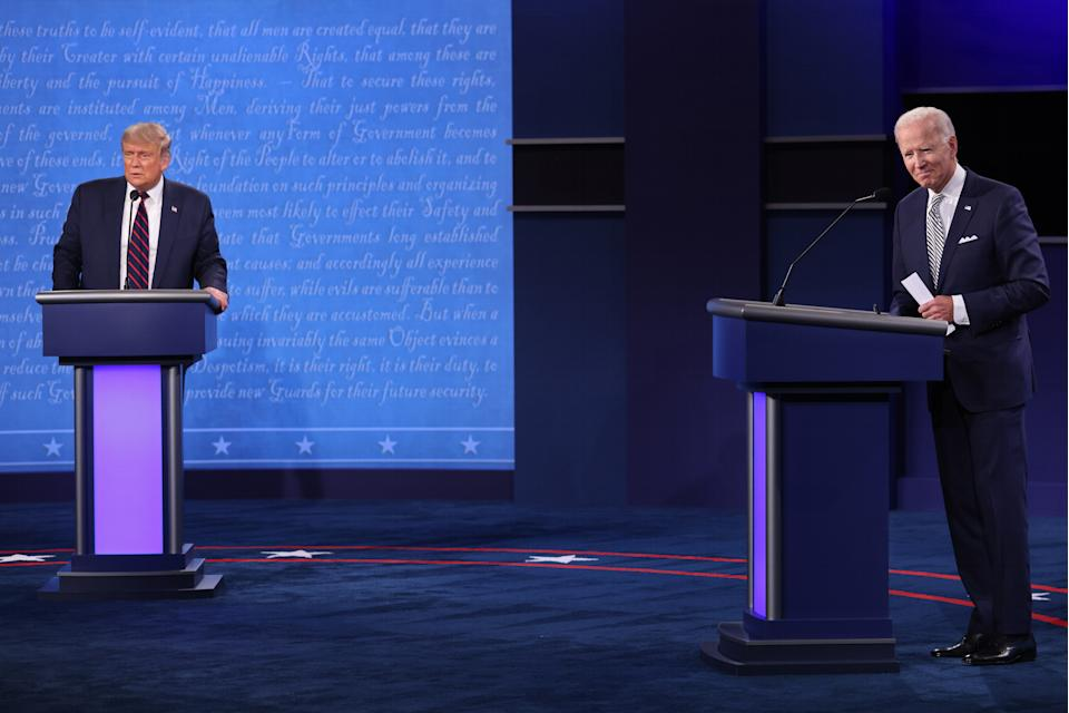 CLEVELAND, OHIO - SEPTEMBER 29:  U.S. President Donald Trump and Democratic presidential nominee Joe Biden look out to the audience at end of the first presidential debate at the Health Education Campus of Case Western Reserve University on September 29, 2020 in Cleveland, Ohio. This is the first of three planned debates between the two candidates in the lead up to the election on November 3. (Photo by Win McNamee/Getty Images)