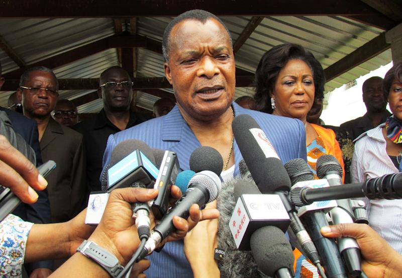 Congolese President Denis Sassou Nguessou talks to the media after voting on October 25, 2015 in Brazzaville