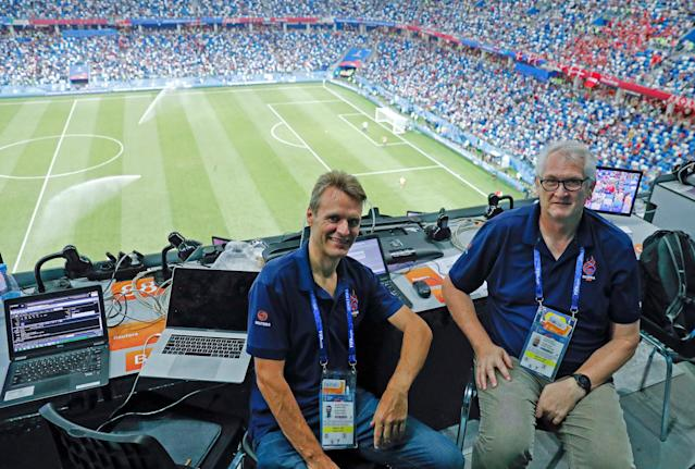 FILE PHOTO: Reuters journalists Andrew Cawthorne (L) and Mark Gleeson sit in the media tribune during the match between Croatia and Denmark at the Nizhny Novgorod Stadium, Nizhny Novgorod, Russia, July 1, 2018. REUTERS/Max Rossi/File Photo