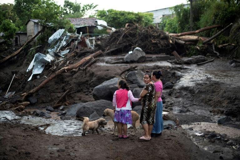 Survivors of the landslide that buried some 50 homes look at washed away buildings in Nejapa, just outside the city of San Salvador, on October 30, 2020