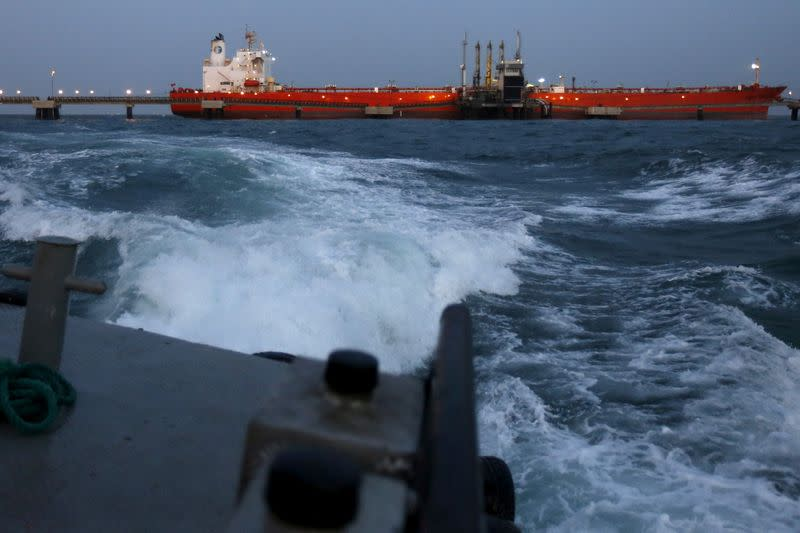FILE PHOTO: An oil tanker is docked while oil is pumped into it at the ships terminal of PDVSA's Jose Antonio Anzoategui industrial complex in the state of Anzoategui