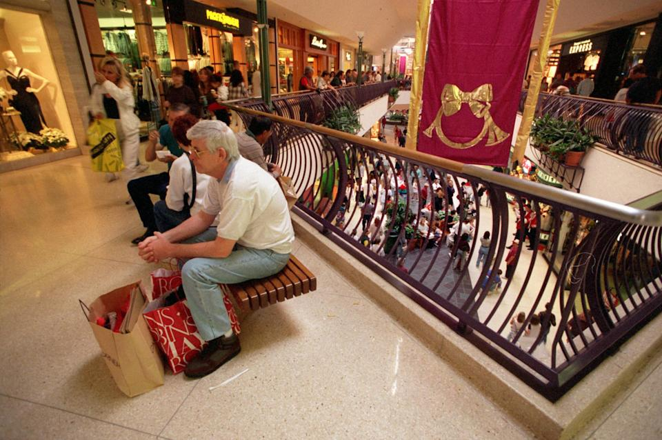 Photo of people shopping in the mall during Christmastime