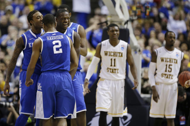 Kentucky players from left, guard/forward James Young (1), guard Aaron Harrison (2) and forward Julius Randle (30) celebrate against Wichita State during the second half of a third-round game of the NCAA college basketball tournament Sunday, March 23, 2014, in St. Louis. (AP Photo/Jeff Roberson)