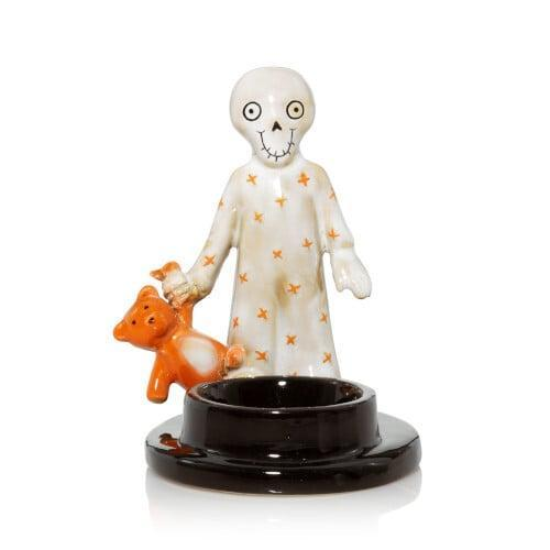 <p>Don't worry, this <span>Boney's Little Companion Tea Light Candle Holder</span> ($15) spooks us, too.</p>
