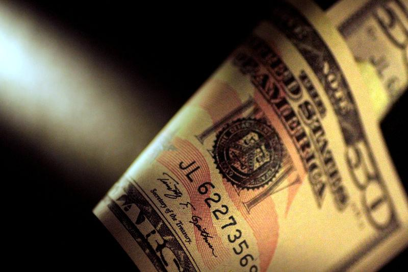 Dollar drops as report casts doubts on trade deal