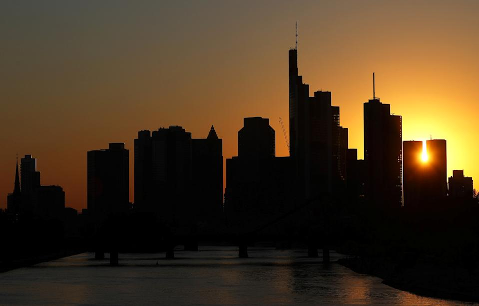 The skyline with its financial district is photographed during sunset in Frankfurt, Germany, April 22, 2020, as the spread of the coronavirus disease (COVID-19) continues.   REUTERS/Kai Pfaffenbach