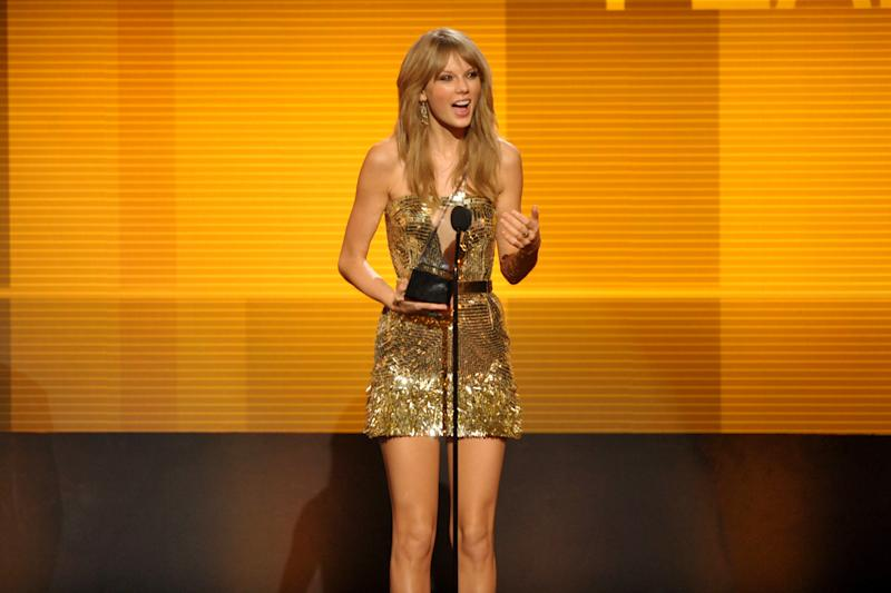 Taylor Swift accepts the award for favorite female artist - country at the American Music Awards at the Nokia Theatre L.A. Live on Sunday, Nov. 24, 2013, in Los Angeles. (Photo by John Shearer/Invision/AP)