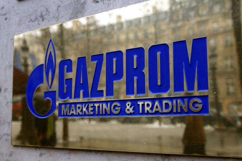 FILE PHOTO: The logo of Gazprom marketing department is seen in front of the office located on the Champs Elysees in Paris