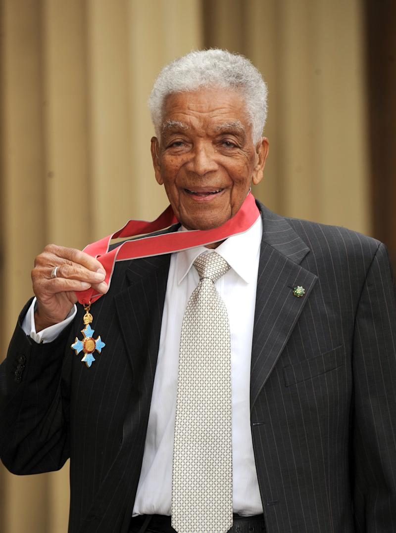 Earl Cameron outside Buckingham Palace after receiving his CBE (Photo: PA)