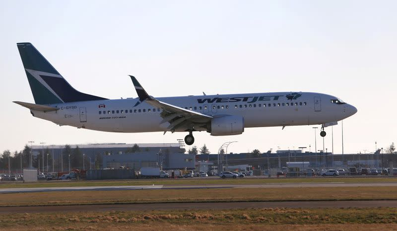 FILE PHOTO: A WestJet Boeing 737 airplane lands at Vancouver's international airport in Richmond,