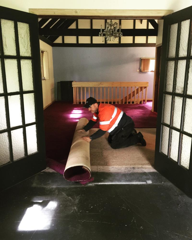 The house was filled with dark purple carpets before the renovation