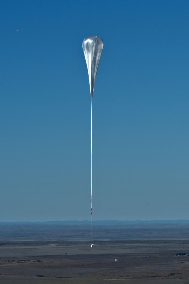 This photo provided by Red Bull shows the balloon lifts up during the helium balloon carrying Felix Baumgartner, Sunday, Oct. 14, 2012, in Roswell, N.M. Baumgartner plans to jump from an altitude of 120,000 feet, an altitude chosen to enable him to achieve Mach 1 in free fall, which would deliver scientific data to the aerospace community about human survival from high altitudes.(AP Photo/Red Bull Stratos, Predrag Vuckovic, HO) MANDATORY CREDIT