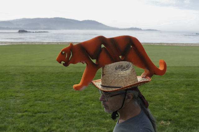 Tiger Woods fan, Robert Drlicka walks along the 18th fairway during a practice round for the U.S. Open Championship golf tournament Tuesday, June 11, 2019, in Pebble Beach, Calif. (AP Photo/Marcio Jose Sanchez)