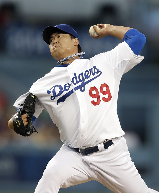Los Angeles Dodgers starting pitcher Hyun-jin Ryu, of South Korea, throws against the San Diego Padres during the first inning of a baseball game on Friday, Aug. 30, 2013, in Los Angeles. (AP Photo/Jae C. Hong)
