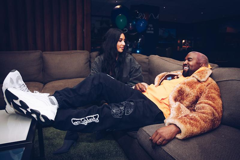 Kim Kardashian and Kanye West relax backstage at The Forum on Dec. 19, 2018 in Inglewood, California. (Photo: Rich Fury/Forum Photos via Getty Images)