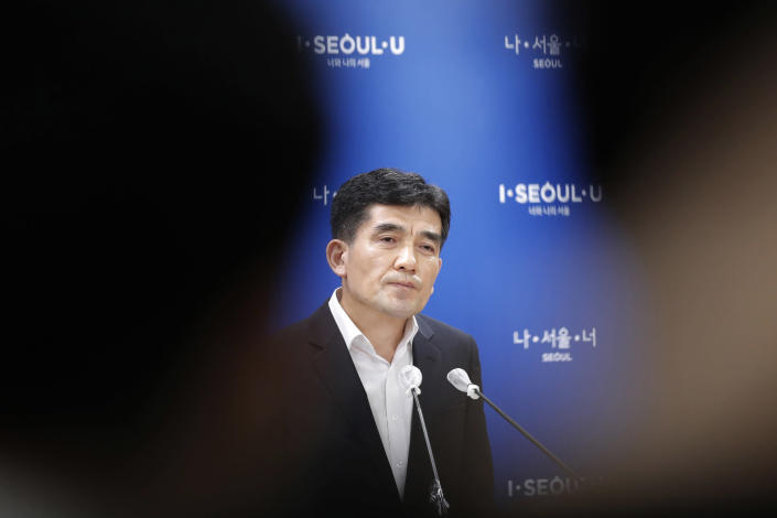 Seoul Metropolitan Government spokesperson Hwang In-sik listens to reporter's question at Seoul City Hall in Seoul, South Korea, Wednesday, July 15, 2020. The city government of the South Korean capital, Seoul, said Wednesday it will launch an investigation into allegations of sexual misconduct surrounding late Mayor Park Won-soon, who was found dead after one of his secretaries filed a complaint claiming yearslong abuse. (AP Photo/Lee Jin-man)