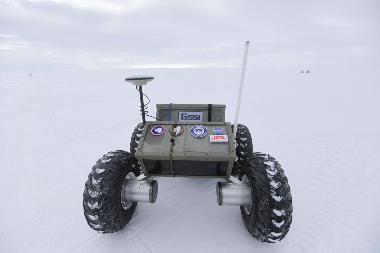 "In this July 15, 2011 photo, the ""Yeti,"" a tractor-like autonomous robot, is tested for eventual deployment of ground-penetrating radar, at Summit Station, a remote research center operated by the U.S. National Science Foundation (NSF), and situated 10,500 feet above sea level, on top of the Greenland ice sheet. Across Greenland's vast white landscape, teams of researchers are searching for clues to the potential effects of global warming on Greenland's ice. (AP Photo/Brennan Linsley)"