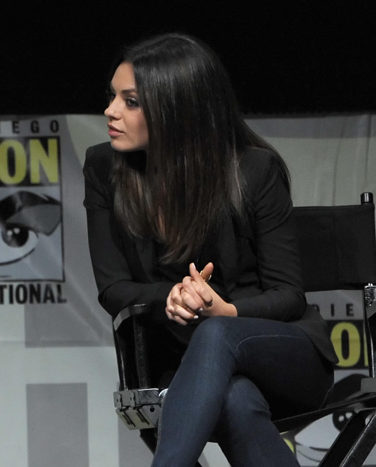 "SAN DIEGO, CA - JULY 12:  Actress Mila Kunis speaks at the ""Oz: The Great and Powerful"" panel during Comic-Con International 2012 at San Diego Convention Center on July 12, 2012 in San Diego, California.  (Photo by Kevin Winter/Getty Images)"