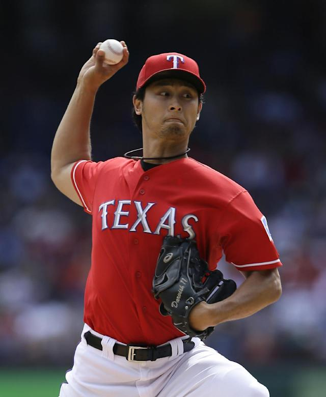 Texas Rangers starting pitcher Yu Darvish (11) of Japan works against the Los Angeles Angels in the first inning of a baseball game, Sunday, Sept. 29, 2013, in Arlington, Texas. (AP Photo/Tony Gutierrez)