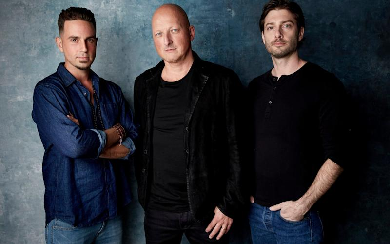 Wade Robson, from left, director Dan Reed and James Safechuck pose for a portrait to promote Leaving Neverland during the Sundance Film Festival - Invision