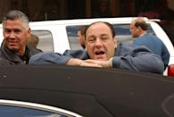 <p>James Gandolfini leans on a car, clad in Tony Soprano's gold jewelry, as he waits to film near The Plaza Hotel. </p>