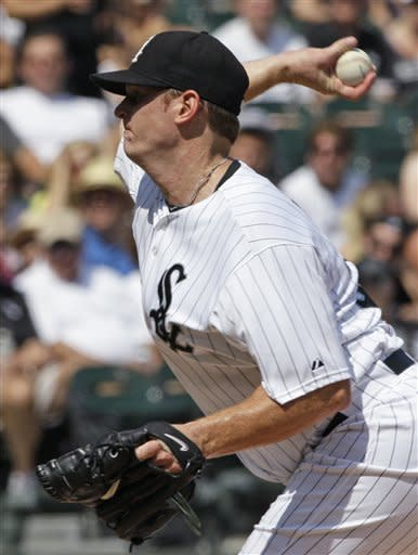 Chicago White Sox starter Gavin Floyd throws to the Toronto Blue Jays during the first inning of a baseball game in Chicago, Saturday, July 7, 2012. (AP Photo/Nam Y. Huh)