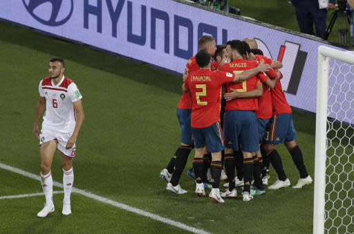 Spain players celebrates his side's opening goal by Spain's Isco during the group B match between Spain and Morocco at the 2018 soccer World Cup in the Kaliningrad Stadium in Kaliningrad, Russia, Monday, June 25, 2018. (AP Photo/Michael Sohn)
