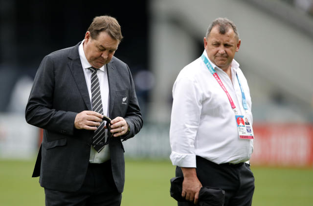 All Blacks coach Steve Hansen and his assistant Ian Foster walk on the pitch ahead of the Rugby World Cup Pool B game at Tokyo Stadium between New Zealand and Namibia in Tokyo, Japan, Sunday, Oct. 6, 2019. (AP Photo/Christophe Ena)