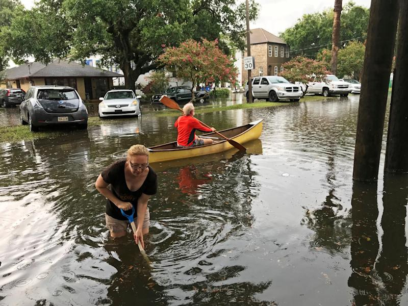 People cope with the aftermath of severe weather in the Broadmoor neighborhood in New Orleans, Wednesday, July 10, 2019. x
